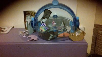 Origami aquarium with aquatic creatures inside