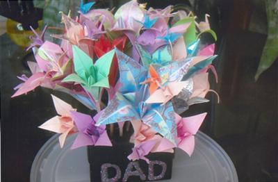 my bunch of origami flowers, look on the petals for the paper cranes